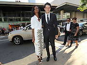 Designer Wes Gordon, right, and model Liya Kebede arrive in a Lexus to the CFDA 2014 Fashion Awards, Monday June 2, 2014 in New York. (Photo by Diane Bondareff/Invision for Lexus/AP Images)