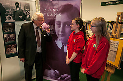 Edinburgh's Bailie Elaine Aitken opened FirrhillHigh School's 'The Anne Frank: A History For Today' exhibition  today. Baillie Aitken was joined by Heather Boyce from the Anne Frank Trust and second generation Holocaust survivors who spoke of their family members' memories of the war. The ceremony was attended by pupils from Firrhill High, local primary schools and retirement home residents from Old Farm Court and Caiystane Court. Emily Mitchell and Alisha Laing (both 12) from Longstone Primary presented Mr Brent with a small bouquet of thanks for his time.  29 April 2014 (c) GER HARLEY | StockPix.eu