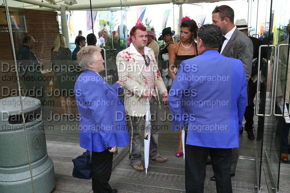 Darren Lyons being refused admittance to the Richmond enclosure because of inappropriate ( jeans , no tie..) dress. . Glorious Goodwood. 2 August 2007.  -DO NOT ARCHIVE-© Copyright Photograph by Dafydd Jones. 248 Clapham Rd. London SW9 0PZ. Tel 0207 820 0771. www.dafjones.com.