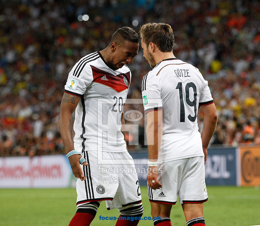 Germany's Mario G&ouml;tze celebrates scoring their first goal with team mate Jerome Boateng during the 2014 FIFA World Cup Final match at Maracana Stadium, Rio de Janeiro<br /> Picture by Andrew Tobin/Focus Images Ltd +44 7710 761829<br /> 13/07/2014