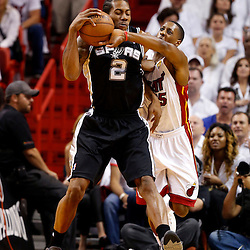 Jun 9, 2013; Miami, FL, USA;  Miami Heat point guard Mario Chalmers (15) defends against San Antonio Spurs small forward Kawhi Leonard (2) during the first quarter of game two of the 2013 NBA Finals at the American Airlines Arena. Mandatory Credit: Derick E. Hingle-USA TODAY Sports