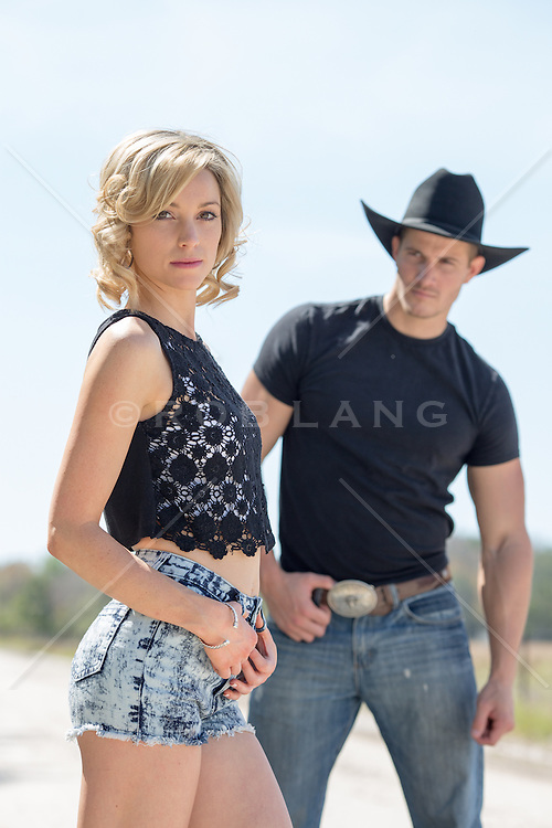cowboy looking at a hot girl outdoors