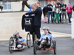 The  Duke of Cambridge is given a sweat shirt with his wifes name on it by wounded service personnel  during a visit to the Help For Heroes Recovery Centre in Tidworth, Wiltshire, Monday, 20th May 2013 Picture by:  Stephen Lock / i-Images