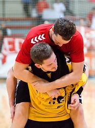 Bostjan Kavas and Aljosa Stefanic of Gorenje celebrate at handball match of MIK 1st Men league between RD Slovan and RK Gorenje Velenje, on May 16, 2009, in Arena Kodeljevo, Ljubljana, Slovenia. Gorenje won 27:26. (Photo by Vid Ponikvar / Sportida)