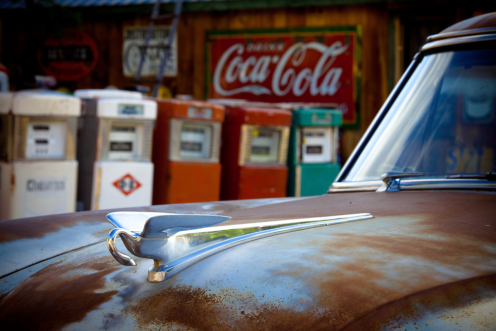 Hood ornament and old gas pumps.