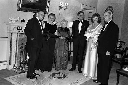 President John F. Kennedy entertained at a dinner party given by President Eamon de Valera at Áras an Uachtarain. Included in the group are An Taoiseach Seán Lemass,  Sinéad Bean de Valera and Mrs. Eunice Shriver..26.06.1963