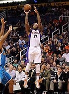 Nov. 23, 2012; Phoenix, AZ, USA; Phoenix Suns forward P.J. Tucker (17) shoots the ball during the game against the New Orleans Hornets in the second half at US Airways Center. The Suns defeated the Hornets 111-108 in overtime. Mandatory Credit: Jennifer Stewart-US PRESSWIRE