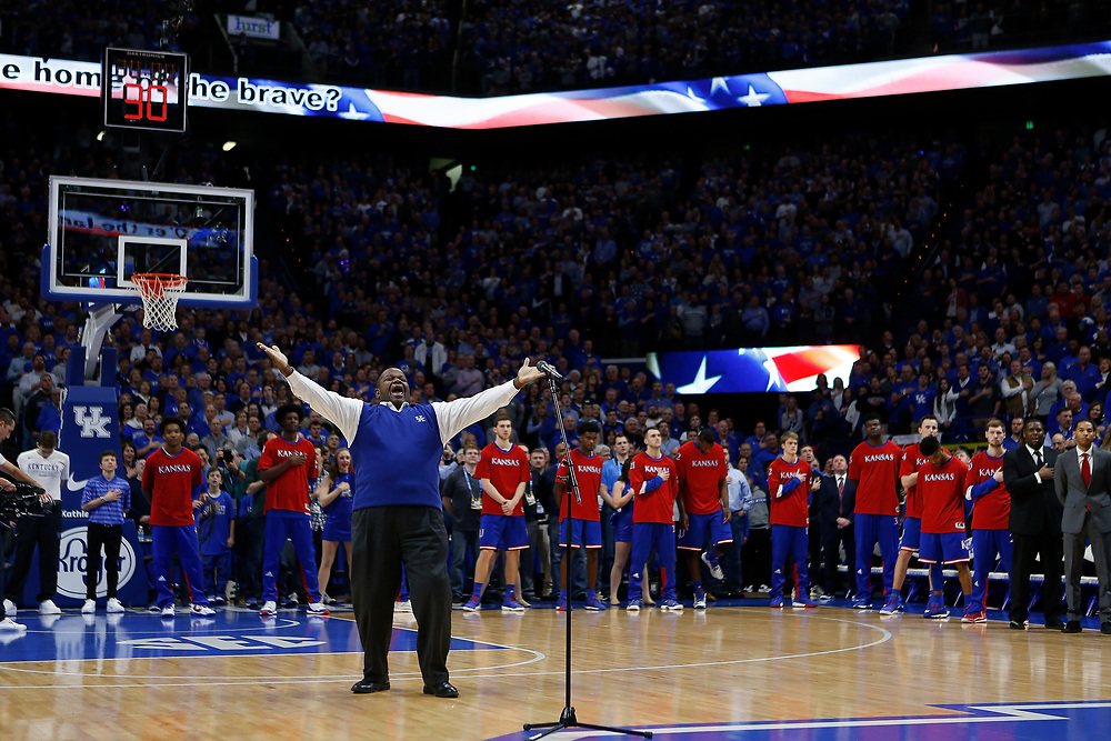 UK Opera Theatre Director Everett McCorvey leads the crowd in a singing of the national anthem prior to the game between the Kentucky Wildcats and Kansas Jayhawks on Saturday January 28, 2017 at Rupp Arena in Lexington, Ky. Photo by Michael Reaves | Staff