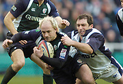 2004/05 Zurich Premiership,London Irish vs Sale Sharks, Madejski Stadium, Reading, ENGLAND: Bryan Redpath with a diving tackle pulls down mark Mapletoft...Photo  Peter Spurrier. .email images@intersport-images...