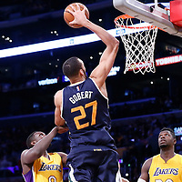 05 December 2016: Utah Jazz center Rudy Gobert (27) goes for the dunk against Los Angeles Lakers forward Luol Deng (9) and Los Angeles Lakers forward Julius Randle (30) during the Utah Jazz 107-101 victory over the Los Angeles Lakers, at the Staples Center, Los Angeles, California, USA.