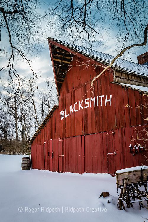 blacksmith red barn in snow hodge park Kansas City Missouri