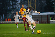 Dundee FC Defender Paul McGinn gets dundees only shot in the first half during the Ladbrokes Scottish Premiership match between Motherwell and Dundee at Fir Park, Motherwell, Scotland on 12 December 2015. Photo by Craig McAllister.