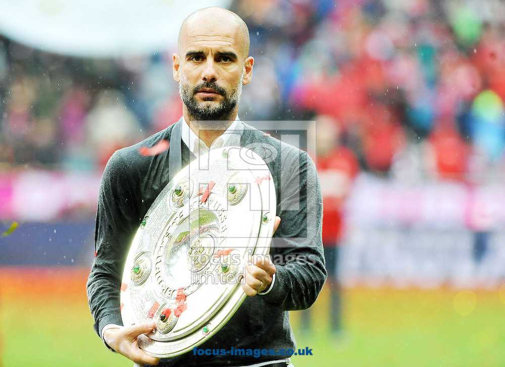 Pep Guardiola, head coach of Bayern Munich with the Bundesliga trophy following the Bundesliga match at Allianz Arena, Munich<br /> Picture by EXPA Pictures/Focus Images Ltd 07814482222<br /> 14/05/2016<br /> ***UK &amp; IRELAND ONLY***<br /> EXPA-EIB-160514-0147.jpg