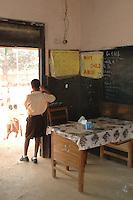 Ghana, Accra, Kokomlemle, 2007. An elementary student watches recess from the doorway of his classroom at Kwameh Nkrumah Memorial School.