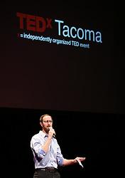 Adam Utley opening TEDx Tacoma on Saturday, March 21, 2015. (Photo: John Froschauer/PLU)