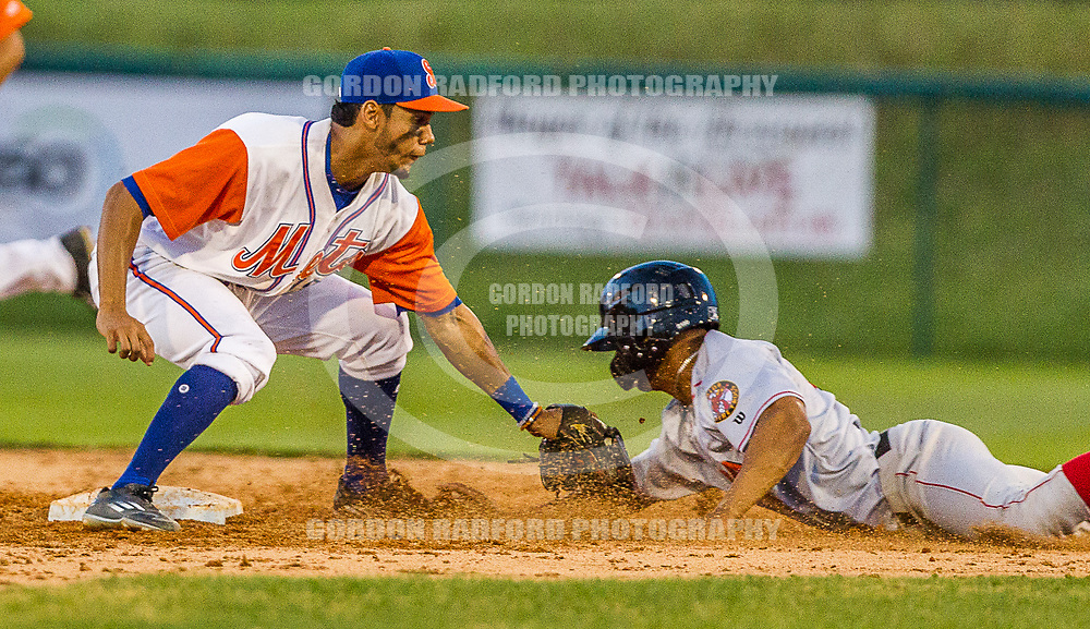 J.C. Rodriguez tags out a runner.