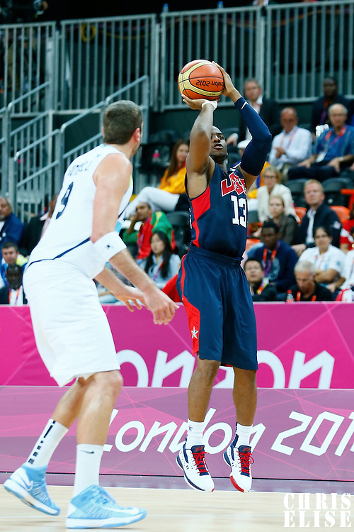 06 August 2012: USA Chris Paul takes a three points jumpshot during 126-97 Team USA victory over Team Argentina, during the men's basketball preliminary, at the Basketball Arena, in London, Great Britain.