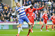 Reading FC striker Matej Vydra battles for the ball with Cardiff City defender Bruno Ecuele Manga during the Sky Bet Championship match between Reading and Cardiff City at the Madejski Stadium, Reading, England on 19 March 2016. Photo by Mark Davies.