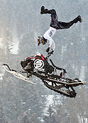 NEWS&GUIDE PHOTO / PRICE CHAMBERS.Kourtney Hungerford gets some major air as he pulls this trick during the freestyle snowmobile event at the rodeo grounds on Saturday evening. More than ten riders jumped their snowmachines before a large audience as part of the hillclimb festivities.