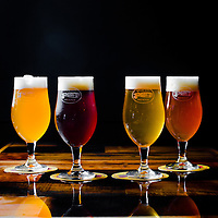 TAMPA, FL --  La Rubia Golden Ale, left to right, Grass Fed Red, Fountain of YOuth, and Northdale Pale Ale is served at the Cigar City Brewing Brewpub in Tampa, Florida.  (Photo / Chip Litherland)