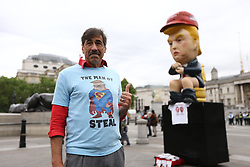 © Licensed to London News Pictures. 04/06/2019. London, UK. People are starting to gather in Trafalgar Square this morning ahead of a protest against President Donald Trumps state visit to the UK. Photo credit: Andrew McCaren/LNP