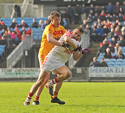 Ballintubber&rsquo;s Michael Plunkett tries to get past Castlebar Mitchels Eoghan Reilly during the County Senior final at McHale park on sunday last.<br /> Pic Conor Mckeown