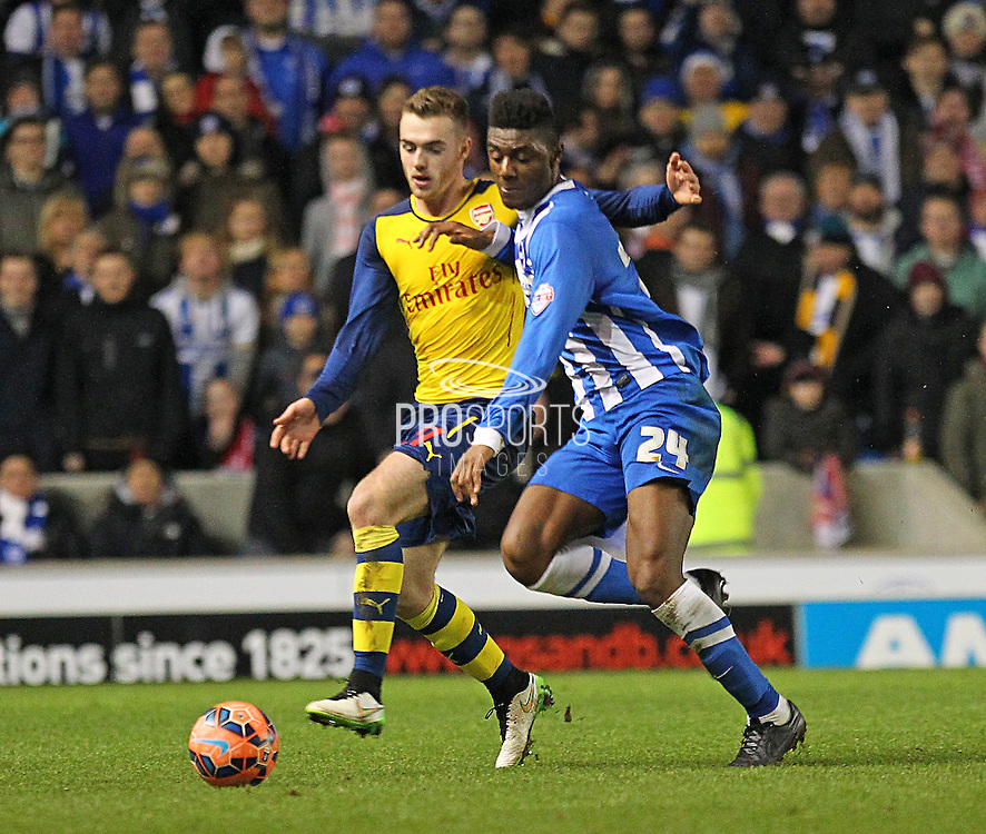 Arsenal's Calum Chambers battles with Brighton's Rohan Ince during the The FA Cup match between Brighton and Hove Albion and Arsenal at the American Express Community Stadium, Brighton and Hove, England on 25 January 2015. Photo by Phil Duncan.