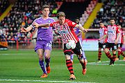Plymouth Argyle's Jordan Houghton and Exeter City's Christian Ribeiro during the Sky Bet League 2 match between Exeter City and Plymouth Argyle at St James' Park, Exeter, England on 2 April 2016. Photo by Graham Hunt.