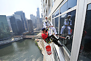 A Colonel Sanders impersonator delivers lunch to a window washer as part of a KFC promotion on May 10, 2011 in Chicago. (For KFC)
