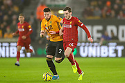 Liverpool defender Andrew Robertson (26) tussles with Wolverhampton Wanderers defender Matt Doherty (2) during the Premier League match between Wolverhampton Wanderers and Liverpool at Molineux, Wolverhampton, England on 23 January 2020.