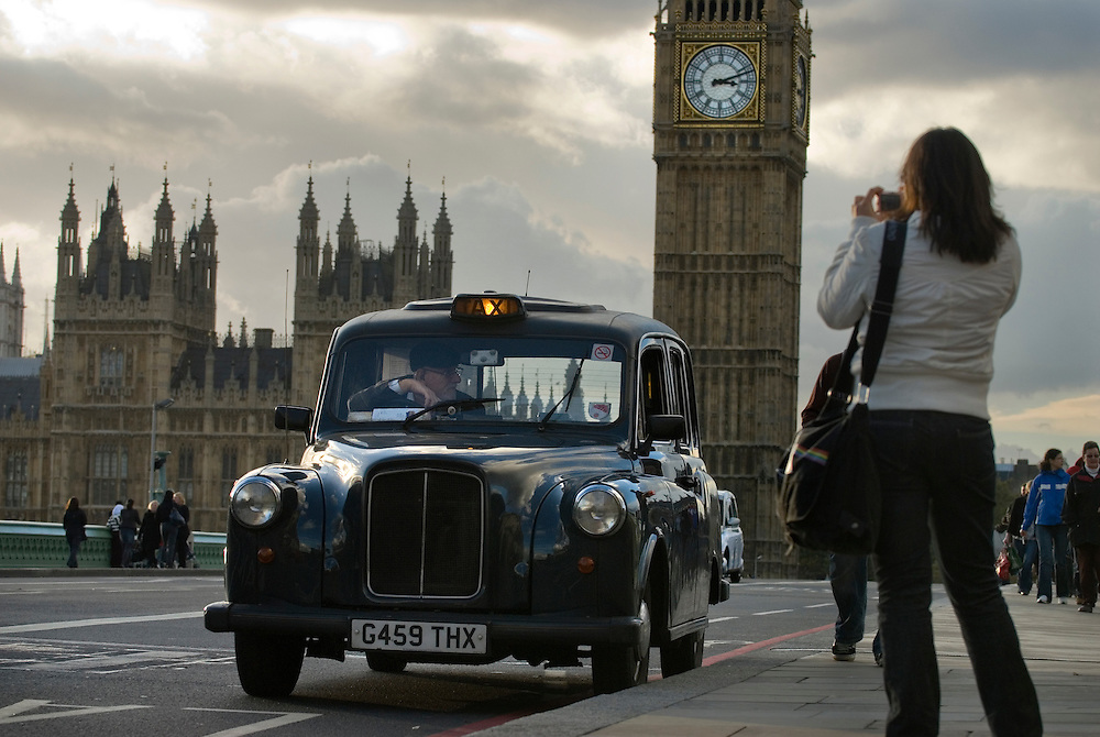 United Kingdom. London. London Taxis near the Houses of Parliament in Westminster...