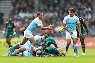Mike Blair of Newcastle Falcons (left) passes clear during the Aviva Premiership match at Welford Road, Leicester<br /> Picture by Andy Kearns/Focus Images Ltd 0781 864 4264<br /> 06/09/2014