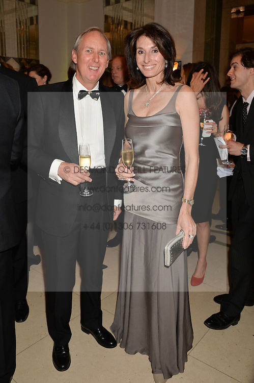 CHARLIE MAYHEW and TRACEY CURTIS-TAYLOR at the Tusk Friends Dinner in aid of wildlife charity Tusk held at Claridge's, Brook Street, London on 11th March 2014.