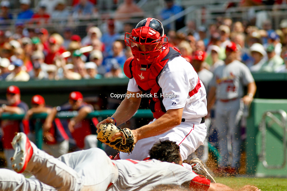 March 15, 2012; Fort Myers, FL, USA; St. Louis Cardinals third baseman Matt Carpenter (62) slides past Boston Red Sox catcher Ryan Lavarnway (60) for a run during off a Erik Komatsu double during the top of the second inning of a spring training game at Jet Blue Park. Mandatory Credit: Derick E. Hingle-US PRESSWIRE