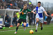 Scunthorpe United Forward, Paddy Madden (9) and Bristol Rovers Defender, Ryan Sweeney (33) during the EFL Sky Bet League 1 match between Bristol Rovers and Scunthorpe United at the Memorial Stadium, Bristol, England on 25 February 2017. Photo by Adam Rivers.