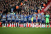 Brighton and Hove Albion players during the minutes appreciation during the Premier League match between Liverpool and Brighton and Hove Albion at Anfield, Liverpool, England on 30 November 2019.