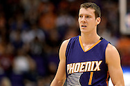 Oct 16, 2014; Phoenix, AZ, USA; Phoenix Suns guard Goran Dragic (1) reacts on the court against the San Antonio Spurs in the first half at US Airways Center. Mandatory Credit: Jennifer Stewart-USA TODAY Sports