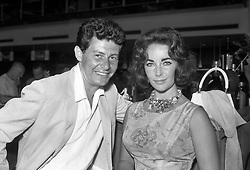 Singer Eddie Fisher and his wife, film star Elizabeth Taylor, on arrival at London Airport, from a holiday in Nice.