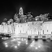 Charlotte skyline at night black and white photo with Romare Bearden Park. Charlotte is a major city in North Carolina in the Eastern United States of America.