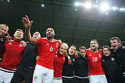 LILLE, FRANCE - Friday, July 1, 2016: Wales' captain Ashley Williams leads his team's celebrations after a 3-1 victory over Belgium and reaching the Semi-Final during the UEFA Euro 2016 Championship Quarter-Final match at the Stade Pierre Mauroy. Simon Church, performance psychologist Ian Mitchall, Jonathan Williams, masseur David Rowe, sports science coach Adam Owen, Sam Vokes, physiotherapist David Weeks, Ronan Kavanagh. (Pic by David Rawcliffe/Propaganda)