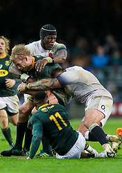 Joe Marler and Maro Itoje of England tackling Pieter-Steph du Toit of South Africa- Mandatory by-line: Steve Haag/JMP - 23/06/2018 - RUGBY - DHL Newlands Stadium - Cape Town, South Africa - South Africa v England 3rd Test Match, South Africa Tour
