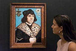 "© Licensed to London News Pictures. 29/06/2018. LONDON, UK. A staff member views ""Portrait of a man with a spotted fur collar"" by Lucas Cranach The Elder (Est. £1.5-2m).  Preview of Old Masters, British, Treasures, Sculptures and Ancient works at Sotheby's New Bond Street to be offered for sale on 3 and 4 July 2018.  Photo credit: Stephen Chung/LNP"