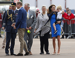 ©  London News Pictures. 08/07/2016. RAF Fairford, UK. CATHERINE, Duchess of Cambridge, Prince GEORGE and Prince WILLIAM during a visit to the International Air Tattoo at RAF Fairford in Gloucestershire where Prince George was introduced to the Red Arrows.  Photo credit: Ian Schofield/LNP