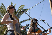 Caroline Isaacs plays washboard during the Silver Thread Trio concert at Fiesta en el Barrio Viejo 2010, Tucson, Arizona.