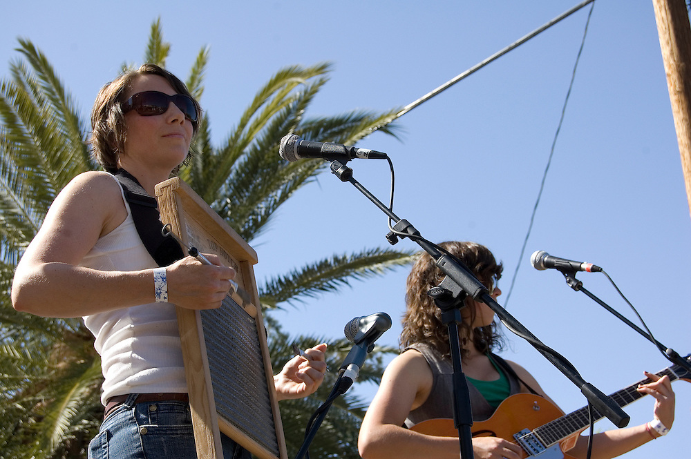 Caroline Isaacs plays washboard during the Silver Thread Trio concert at Fiesta en el Barrio Viejo 2010, Tucson, Arizona. The all-day concert is now known as Fiesta en el Barrio. Event photography by Martha Retallick.
