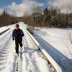 Cross-country skiing over the Pleasant River near the AMC's Little Lyford Pond Camps in Maine's Northern Forest.  Near Greenville.