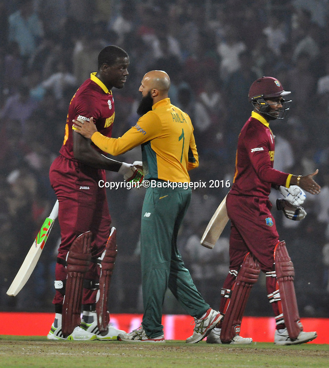 Players shaking hands after the game during the 2016 ICC World T20 cricket match between South Africa and West Indies at Vidharbha Cricket Association, Jamtha, India on 25 March 2016 ©BackpagePix