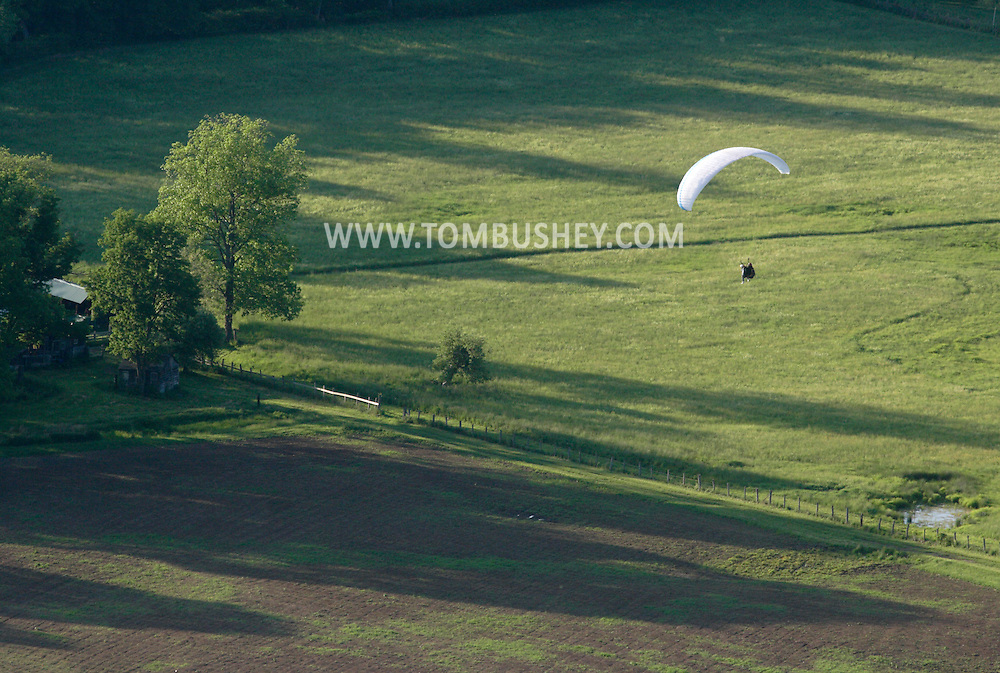 Ellenville, NY - A paraglider comes in for a landing at Ellenville Flight Park on May 30, 2009.