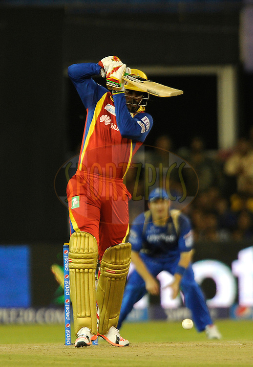 Chris Gayle of Royal Challengers Bangalore bats during match 22 of the Pepsi IPL 2015 (Indian Premier League) between The Rajasthan Royals and The Royal Challengers Bangalore held at the Sardar Patel Stadium in Ahmedabad , India on the 24th April 2015.<br /> <br /> Photo by:  Pal Pillai / SPORTZPICS / IPL