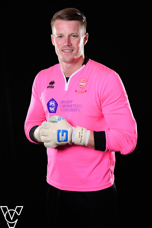 Lincoln City Football Club kit launch ahead of the 2017/18 EFL Sky Bet League Two season.  Pictured is Lincoln City's Paul Farman wearing the pink Errea home goalkeeping shirt, with the Bishop Grosseteste University logo on the front and Sleafordian logo on the back.<br /> <br /> Picture: Chris Vaughan Photography<br /> Date: June 19, 2017